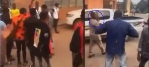 """University students riot as lecturer brings """"loaded gun"""" to exam hall for invigilation (video)"""